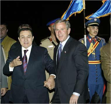 Dictator Hosni Mubarak with his Zioconservative paymaster George Bush